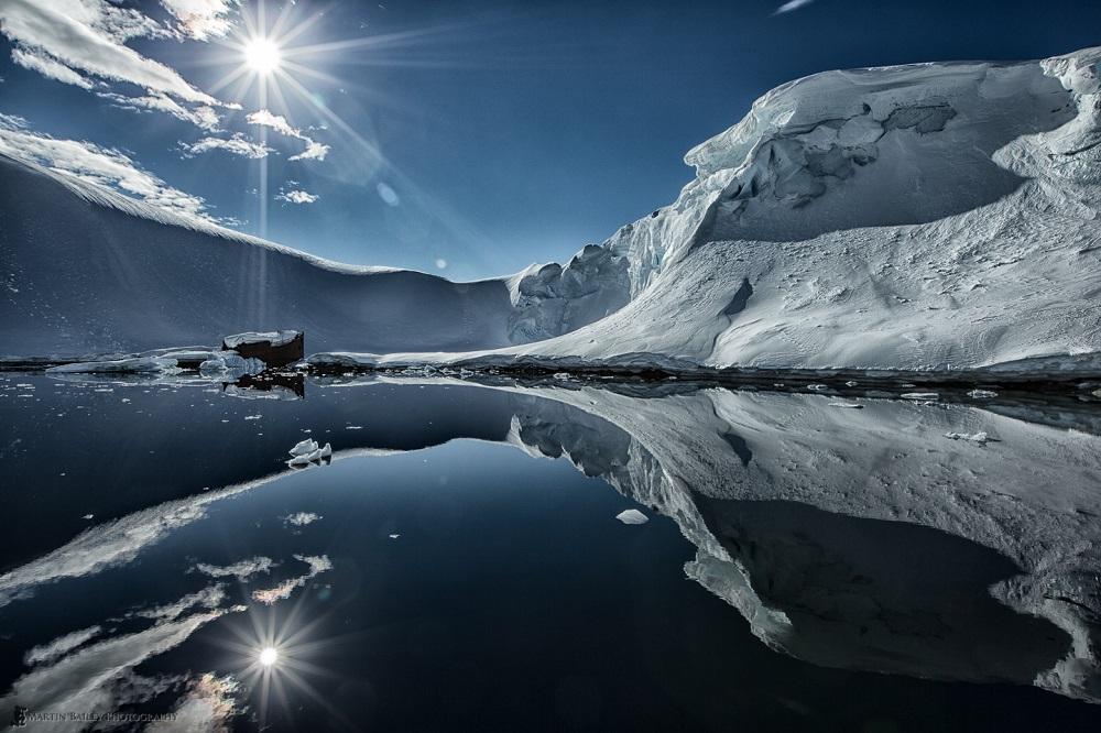 Starburst Reflection - Martin Bailey Antarctica Iceberg